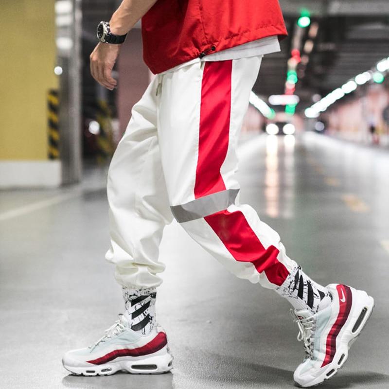 YASUGUOJI 2019 Men Side Striped Harem Pants Reflective Joggers Hip Pop Sweatpants Streetwear Male Casual Fashion Pants Hombre