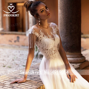Image 5 - Beaded Appliques Lace Wedding Dress Swanskirt Beach Scoop A Line Tulle Illusion Bride gown Desinger Princess robe de mariee NY51