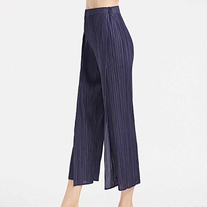TVVOVVIN Color sólido cintura baja banda elástica plisada pantalones partidos Mujer Pantalones rectos moda 2019 otoño invierno nuevo D339 - 4