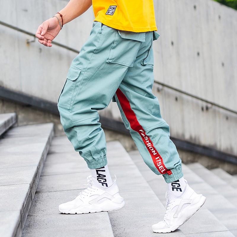 Fashion Streetwear Big Pocket Spliced Men Jeans Joggers Cargo Pants Letter Printed Loose Fit Ankle Banded Hip Hop Pants Jeans