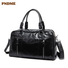 PNDME black genuine leather men's women's travel bag fashion simple high quality cowhide handbag luggage bag casual duffel bag