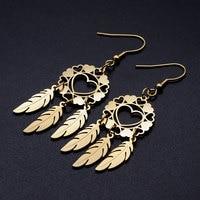 100% en acier inoxydable coeur capteur de rêves Unique goutte boucle d'oreille pour les femmes mode bijoux boucles d'oreilles en gros jamais ternir