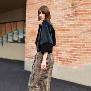 Image 2 - [EAM] luźny krój czarny asymetryczna kurtka ze skóry sztucznej nowa z klapami z długim rękawem płaszcz damski moda fala wiosna jesień 2020 1H079