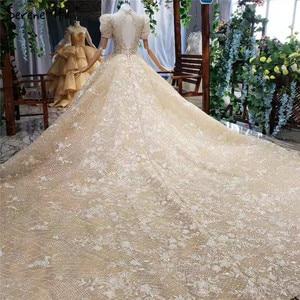 Image 2 - Champagne alta pescoço luxo dubai vestidos de casamento 2020 manga curta lantejoulas rendas até vestidos de noiva hx11612 feito sob encomenda