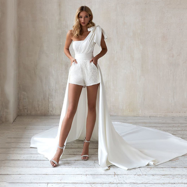 Sequined Jumpsuit Wedding Dresses 2021 One Shoulder Bow Sexy Short Pants Bridal Gown With Pockets Pleat Long Sweep Train 1