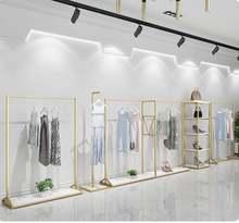 Золотая витрина для магазина одежды напольная подвесная вешалка