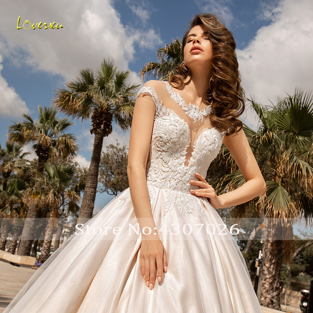 Image 4 - Loverxu Delicate O Neck Ball Gown Wedding Dresses Chic Applique Cap Sleeve Button Bride Dress Chapel Train Bridal Gown Plus Size-in Wedding Dresses from Weddings & Events