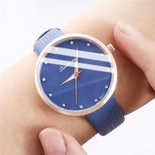 цена New simple leisure student belt watch women 's personalized geometric pattern Fashion quartz watch онлайн в 2017 году