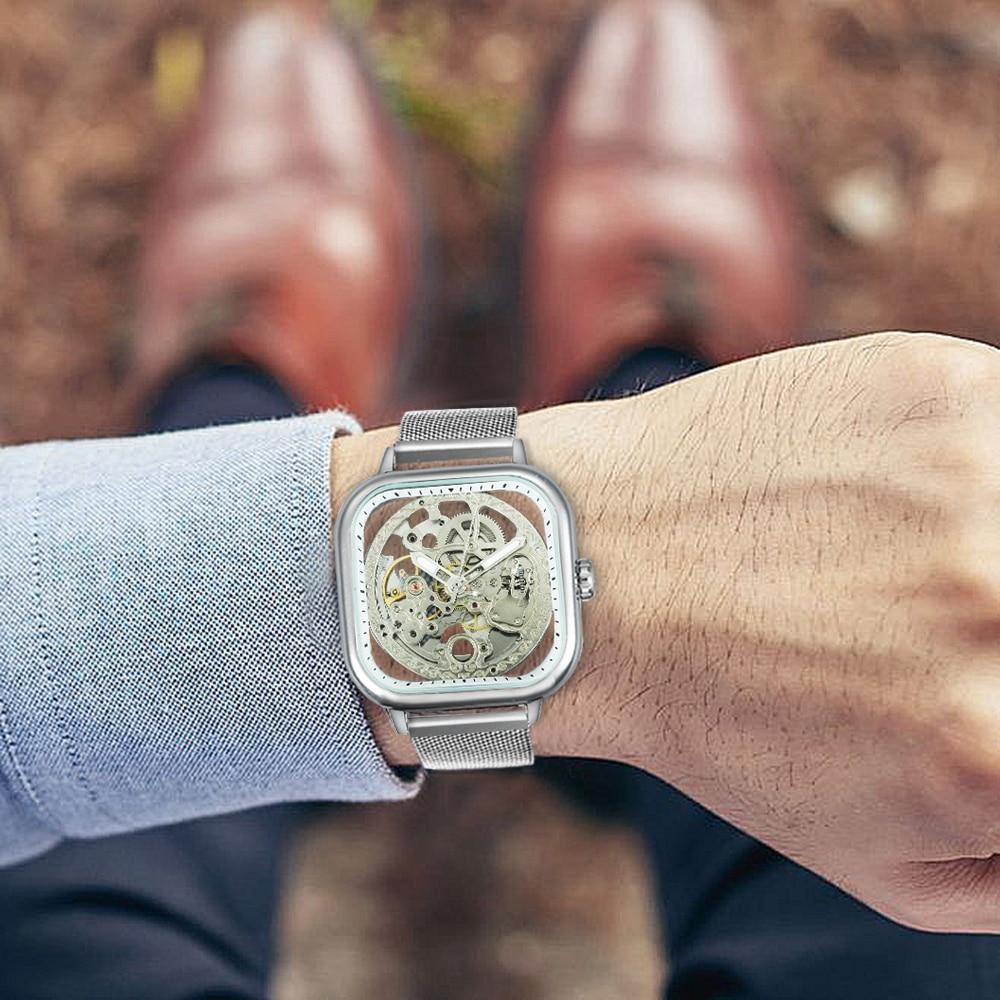 H1e366bb278f444448cbb79ff414504b0B FORSINING Top Brand Luxury Unisex Watch Men Auto Mechanical Hollow Dial Magnet Strap Fashion Royal Wristwatch HIP HOP Male Clock
