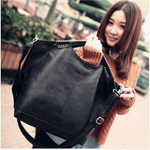 Image 1 - Bolso para mujer de alta calidad, negro, pu, paquete de remaches, grande, famoso diseñador, bolso de hombro, 2020