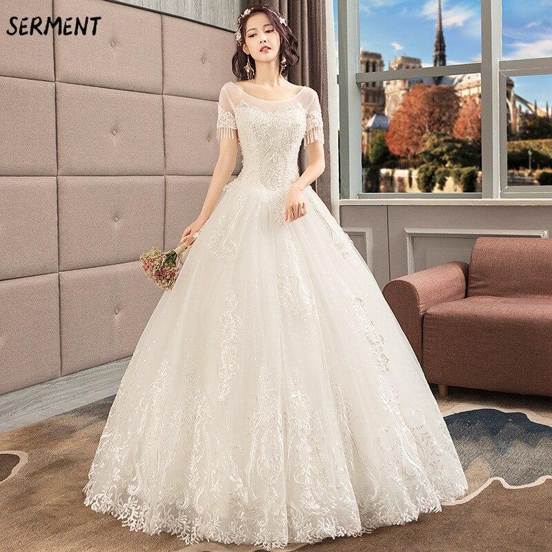 SERMENT Simple impression florale mariage dentelle queue à manches longues aristocratique élégante mariée impression Explosion robe de mariée