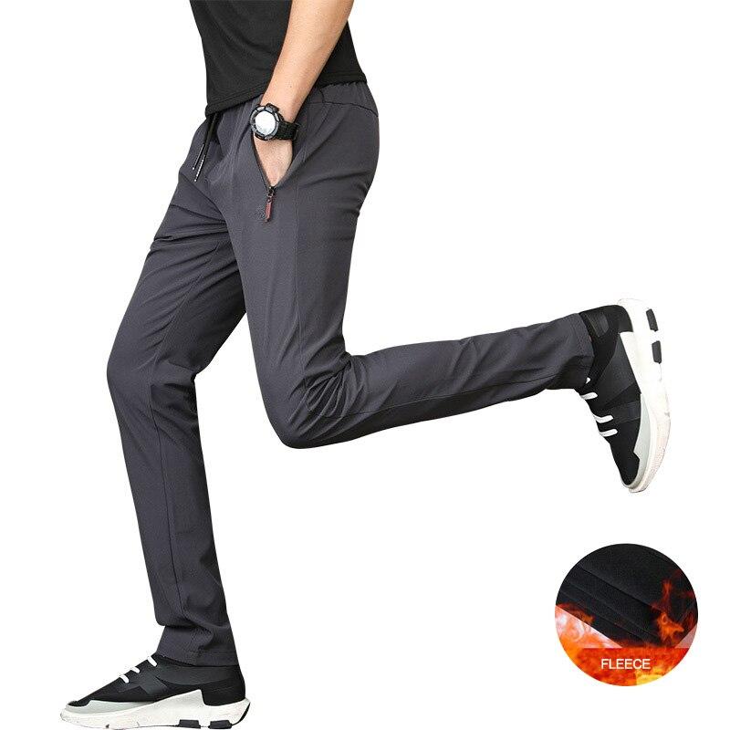 Winter New Men's Fleece Casual Pants 5XL Designer Solid Color Plus Size Slim Stretch Pancel Pant Men Loose SweatPants AFK01