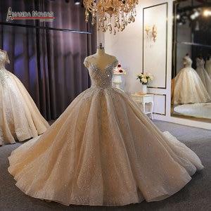 Image 1 - فستان زفاف فاخر ثقيل مطرز بالخرز الشمبانيا دبي فستان الزفاف 2020 صورة عمل حقيقية