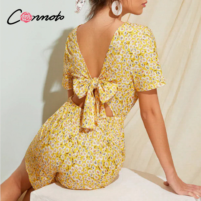 Conmoto Casual Floral Casual Beach Summer Playsuits Women Yellow Short Jumpsuits Rompers Backless Bow Sexy Plus Playsuit Rompers