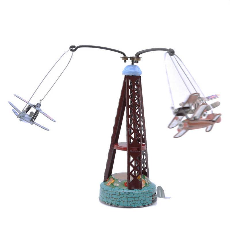 Kurmalı oyuncak dönen uçak atlıkarınca Clockwork teneke oyuncaklar, komik Vintage oyuncak çocuklar için/yetişkin hediye
