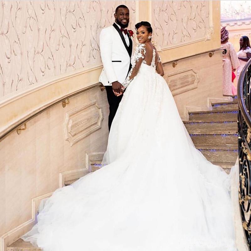 Купить с кэшбэком Lace Long Sleeves Ball Gown Wedding Dress 2018 African Duchess Satin Wedding Gowns For Girls White Sheer Robe