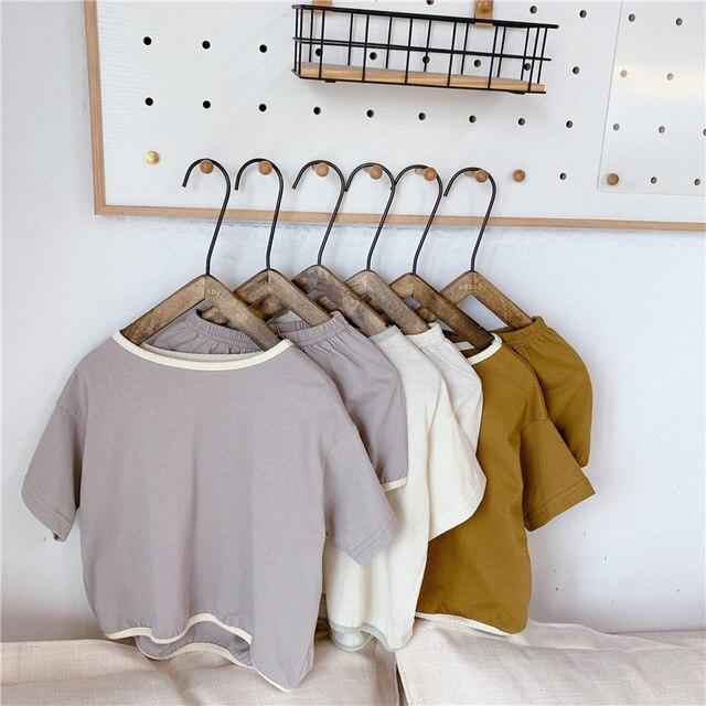 Nowy letni maluch zestawy ubrań dla dzieci dla chłopców i dziewcząt Spure kolor luźne t-shirty spodenki 2 sztuk koreański styl Unisex strój na co dzień Sui