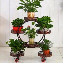 Un soporte de flores portátil barato con ruedas soporte de planta de Metal creativo bandejas de flores organizador gran estante de almacenamiento para la decoración del hogar