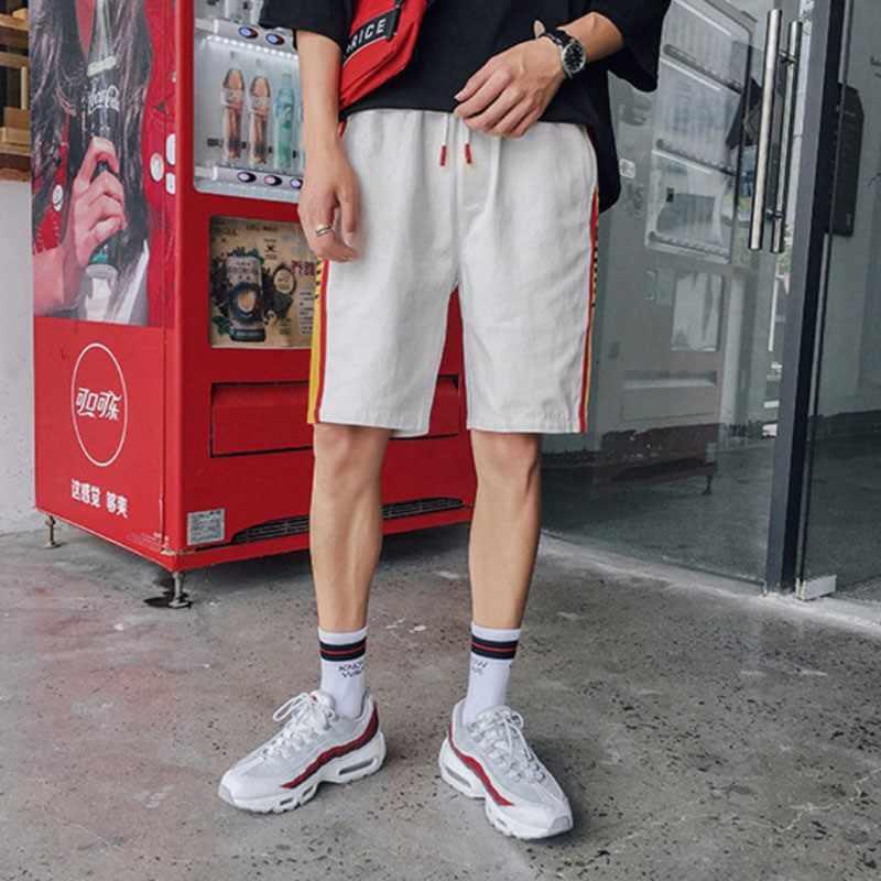 Pantalones L2 de cinco puntos con estampado de Color inglés de ocio holgados de rayas de Color lateral para hombre
