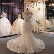 Robe de mariée style sirène en dentelle avec perles, design spécial