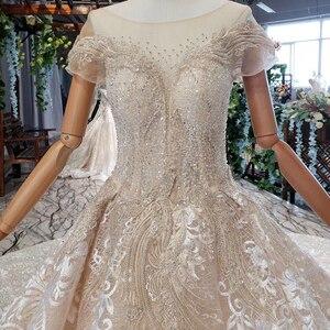 Image 5 - HTL670 ווסטרן תחרה חתונה שמלות אשליה o צוואר קצר שרוולים מחוך טול חתונת שמלת קריסטל חרוז robe דה mariee בוהם