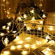 Декоративная гирлянда со звездами снежинками и шариками 220