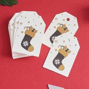 Image 2 - 100 pçs/lote etiqueta de papel de natal branco tag bagagem casamento nota em branco preço pendurar tag feliz natal presente cartão corda 6.8*4.5cm