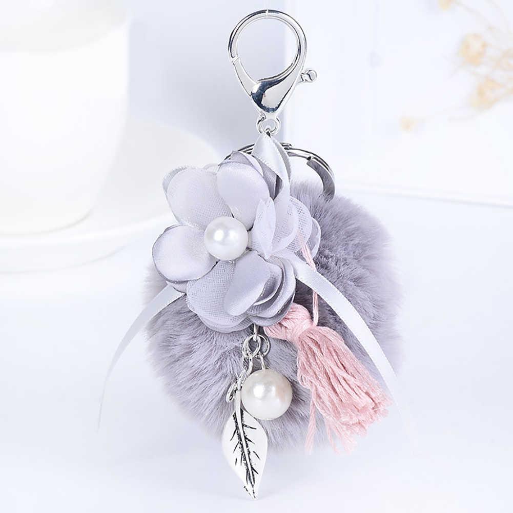 Kabarık hakiki rakun kürk ponpon çanta Bugs anahtarlık peluş anahtarlık deri püskül ponpon anahtarlık peluş top çiçek Tasse
