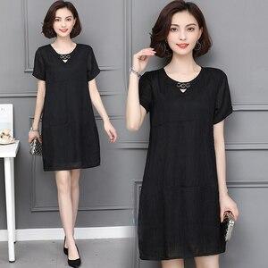 Image 2 - L 5XL ビッグサイズのオフィスの女性カジュアルパーティールース O ネック半袖プラスサイズ夏黒カーキエレガントな女性のカクテルドレス