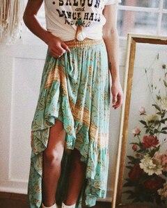 Image 4 - Vintage chic sommer mode frauen floral print strand Böhmischen rock Hohe Elastische Taille Maxi unregelmäßigen A Line Boho Rock Femme