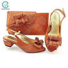 Design italiano nigeriano mais recente banda estreita especial e cross-amarrado estilo sapatos femininos e bolsa conjunto em cor laranja para festa