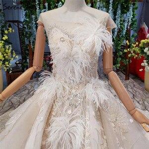 Image 4 - Champagne sans manches robes de mariée Sexy 2020 Dubai luxe paillettes plumes robes de mariée HX0005 sur mesure