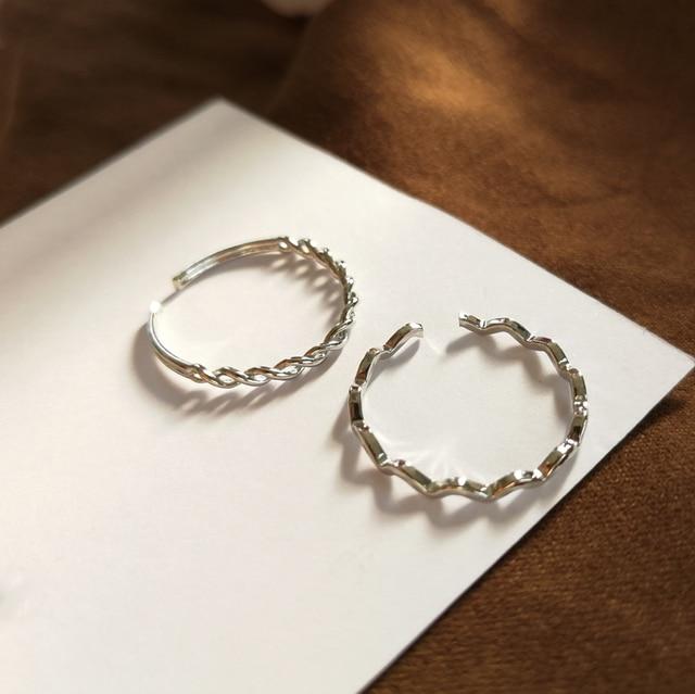 Le japon et la corée du sud personnalité deux pièces anneau quitter vent froid enroulement élément ouvertures ondulé joint anneau queue anneau