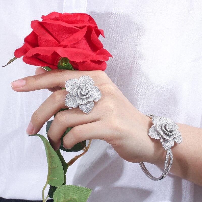 Image 2 - Pulsera y anillo de lujo de moda europea y americana traje de  joyería con incrustaciones brillantes en forma de flor para parejas  Paquete de regaloConjuntos de joyería