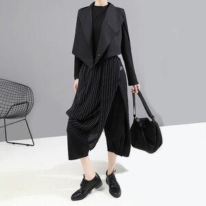 Image 2 - [EAM] pantalones asimétricos negros a rayas con cintura elástica alta, nuevos pantalones holgados ajustados para mujer, tendencia de moda para primavera y otoño 2020 1A933