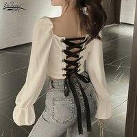 Manga larga de Primavera de blanco blusa Sexy de la clavícula camisa Mochila clásica Cruz hueca corbata negro corto Tops 12577