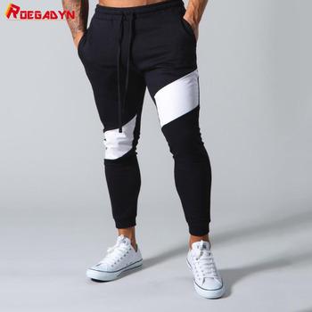 ROEGADYN spodnie do joggingu męskie spodnie dresowe na siłownie spodnie treningowe męskie spodnie dresowe do biegania Trainning Fitness spodnie do biegania męskie spodnie dresowe tanie i dobre opinie COTTON CN (pochodzenie) Elastyczny pas Pełna długość Bieganie Dobrze pasuje do rozmiaru wybierz swój normalny rozmiar