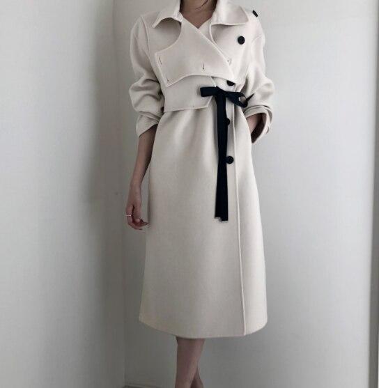 Mujeres Coreanas invierno abrigo de lana largo cálido Color Beige arco morir solo pecho lana ropa de invierno