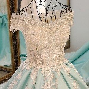 Image 5 - LS21700 חדש כדור שמלת ערב שמלות תחרה עד בחזרה חזרה קצר שרוולי תחרת הערב רשמי שמלות שמלות אור ירוק אמיתי תמונות