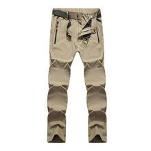 Outdoor mountaineering fishing solid color thin section moisture wicking quick-drying breathable large size stretch pants male