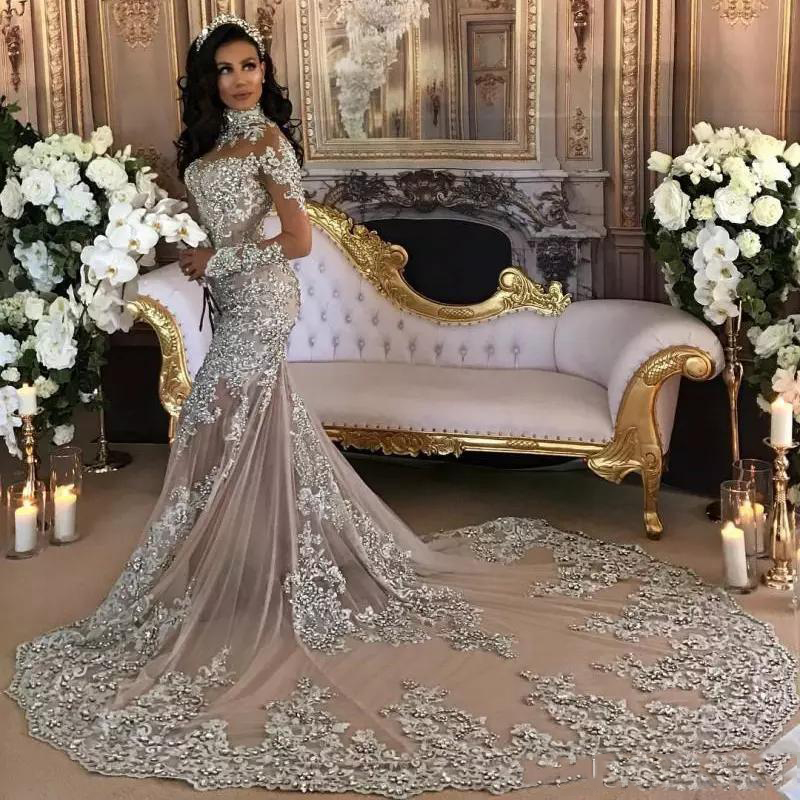 Dubai Arabic Luxury Sparkly Wedding Dresses Sexy Bling Beaded Lace Applique High Neck Illusion Long Sleeve Mermaid Chapel Trai N