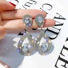 купить FYUAN Shiny Rhinestone Geometric Drop Earrings for Women Bijoux Silver Color Water Drop Crystal Dangle Earring Wedding Jewelry по цене 151.1 рублей