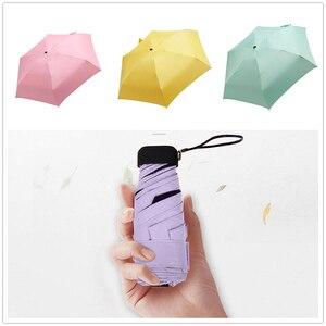 Image 2 - Regenachtige Dag Pocket Paraplu Mini Vouwen Parasols Parasol Zon Opvouwbare Paraplu Mini Paraplu Candy Kleur Reizen Regenkleding