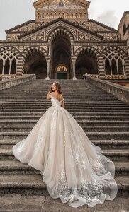 Image 3 - فساتين زفاف من Waulizane مصنوعة حسب الطلب على الكتف مع دانتيل رائع