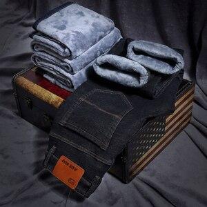 Image 2 - 2020 hommes mode hiver jean hommes noir Slim Fit Stretch épais velours pantalon chaud jean décontracté polaire pantalon mâle grande taille