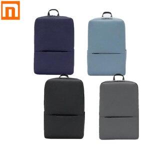 Image 1 - Классический деловой рюкзак Xiaomi, водонепроницаемая уличная Дорожная сумка унисекс для ноутбука 5,6 дюйма, 18 л