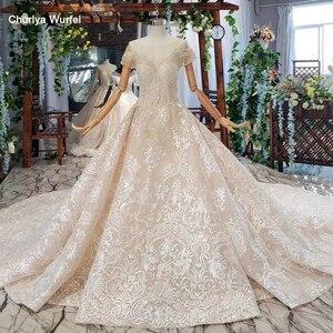 Image 1 - HTL670 ווסטרן תחרה חתונה שמלות אשליה o צוואר קצר שרוולים מחוך טול חתונת שמלת קריסטל חרוז robe דה mariee בוהם