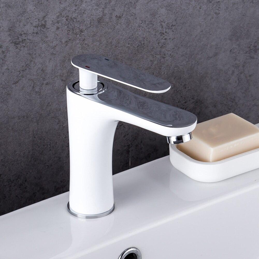 Robinet de bassin de salle de bains à la maison blanc noir peinture Type de levage cuivre eau chaude et froide robinet de bassin de mitigeur monotrou