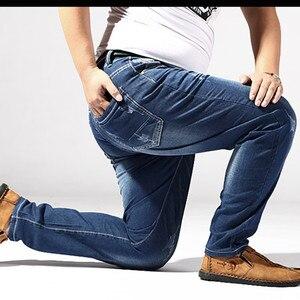 Image 4 - Dżinsy w dużym rozmiarze mężczyźni 6XL 7XL 8XL 180KG ubrania spodnie Homme Stretch proste luźne spodnie Denim niebieski Plus Jean marki zgrywanie spodnie