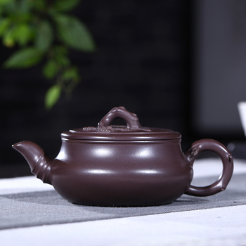 Yixing ores are recommended by hand the teapot tea ores old plum flower purple clay evergreen pot capacity is 210 mm